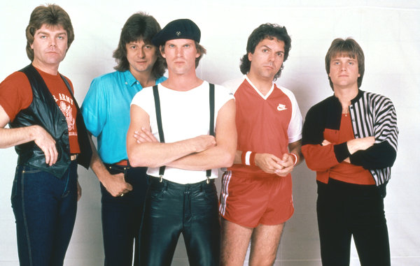 Survivor at the peak of their 'Eye of the Tiger' fame. Songwriter-keyboardist Jim Peterik is second from the left in the light blue shirt, singer Dave Bickler is in the leather pants with his signature beret, songwriter-guitarist Frankie Sullivan is on the right. The gym shorts are unexplained.