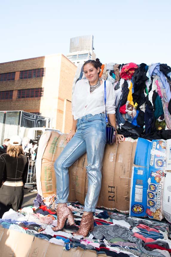 Amirah Kassem poses atop recycled textiles.