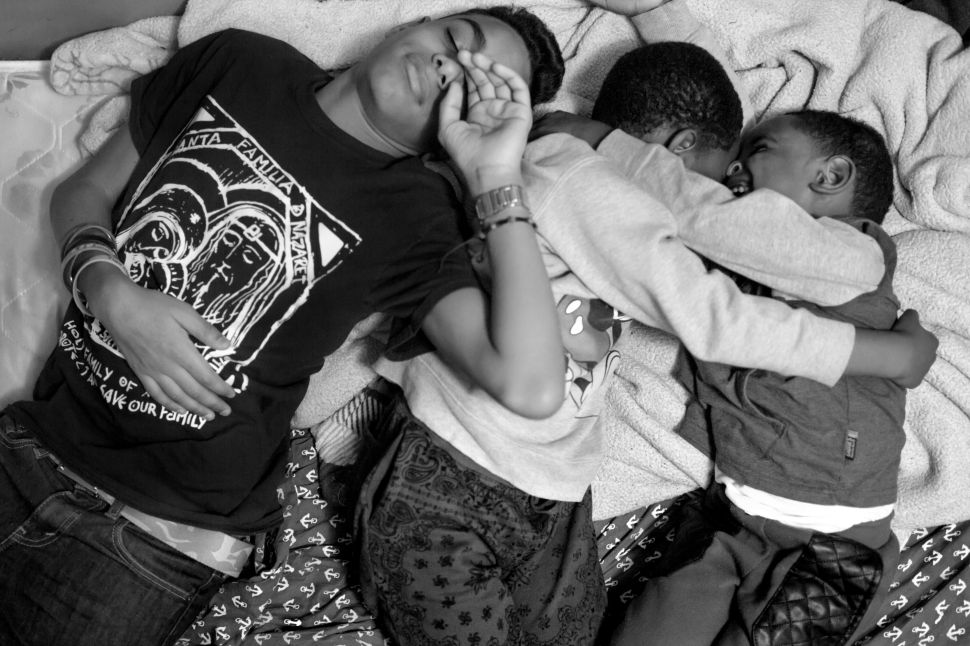 Chavier rests with his two cousins, Jeremy and Jerry. Chavi's family is from the Dominican Republic, but keep strong family connections in New York.