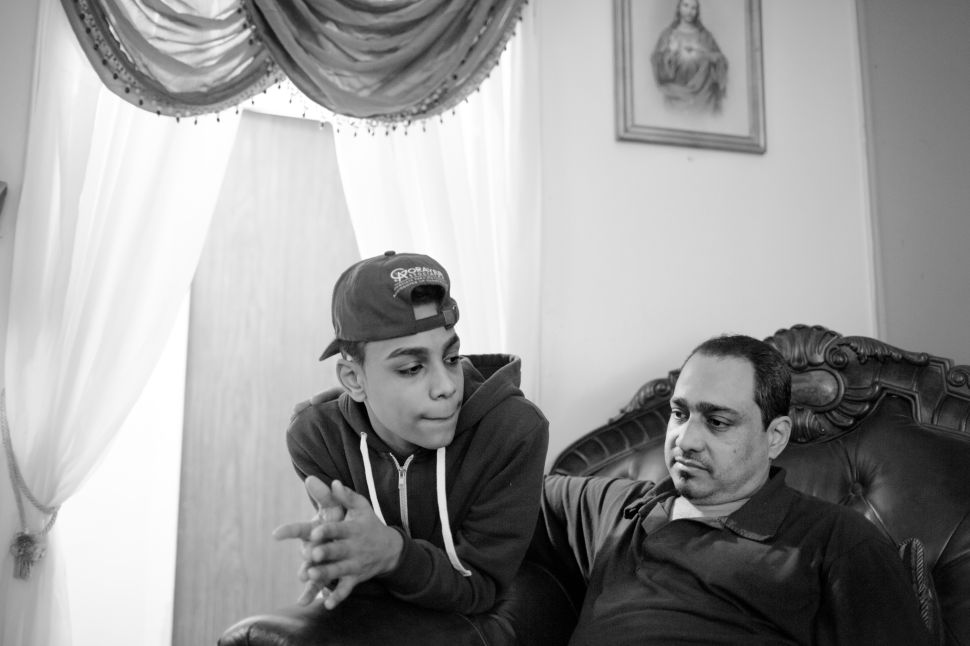 Chavier and his father Frank Leon inside of their apartment. Frank is one of Chavi's greatest supporters, pushing him to succeed and graduate high school.