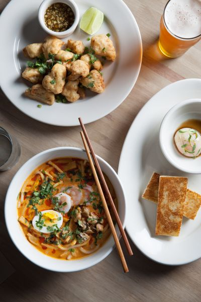 Cassia's fried cauliflower, kaya toast and laksa pair well with a beer.