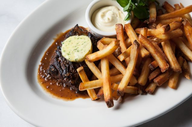 The Creekstone Farms steak frites at Cassia comes with a Phú Quốc island peppercorn sauce.