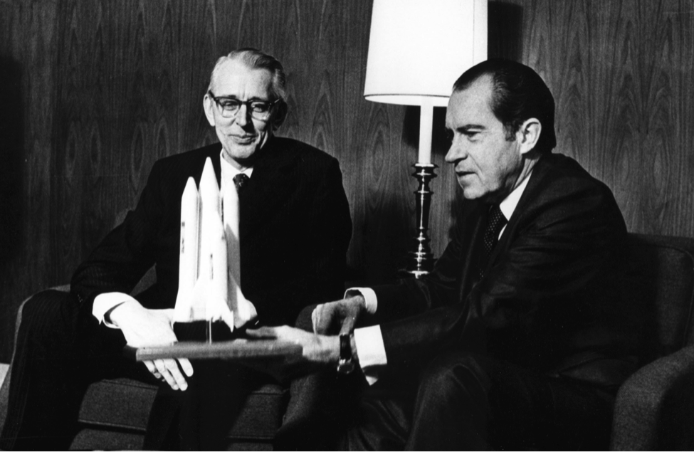 NASA Administrator Dr. James C. Fletcher presenting a Space Shuttle concept to President Nixon in 1972.