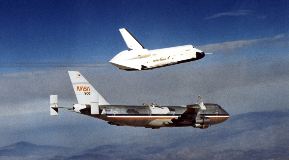 Space Shuttle Enterprise being detached from NASA's 747 ferry aircraft.