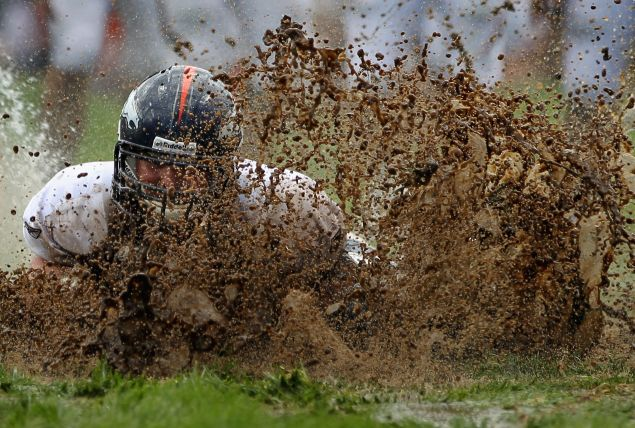 NFL Players in mud
