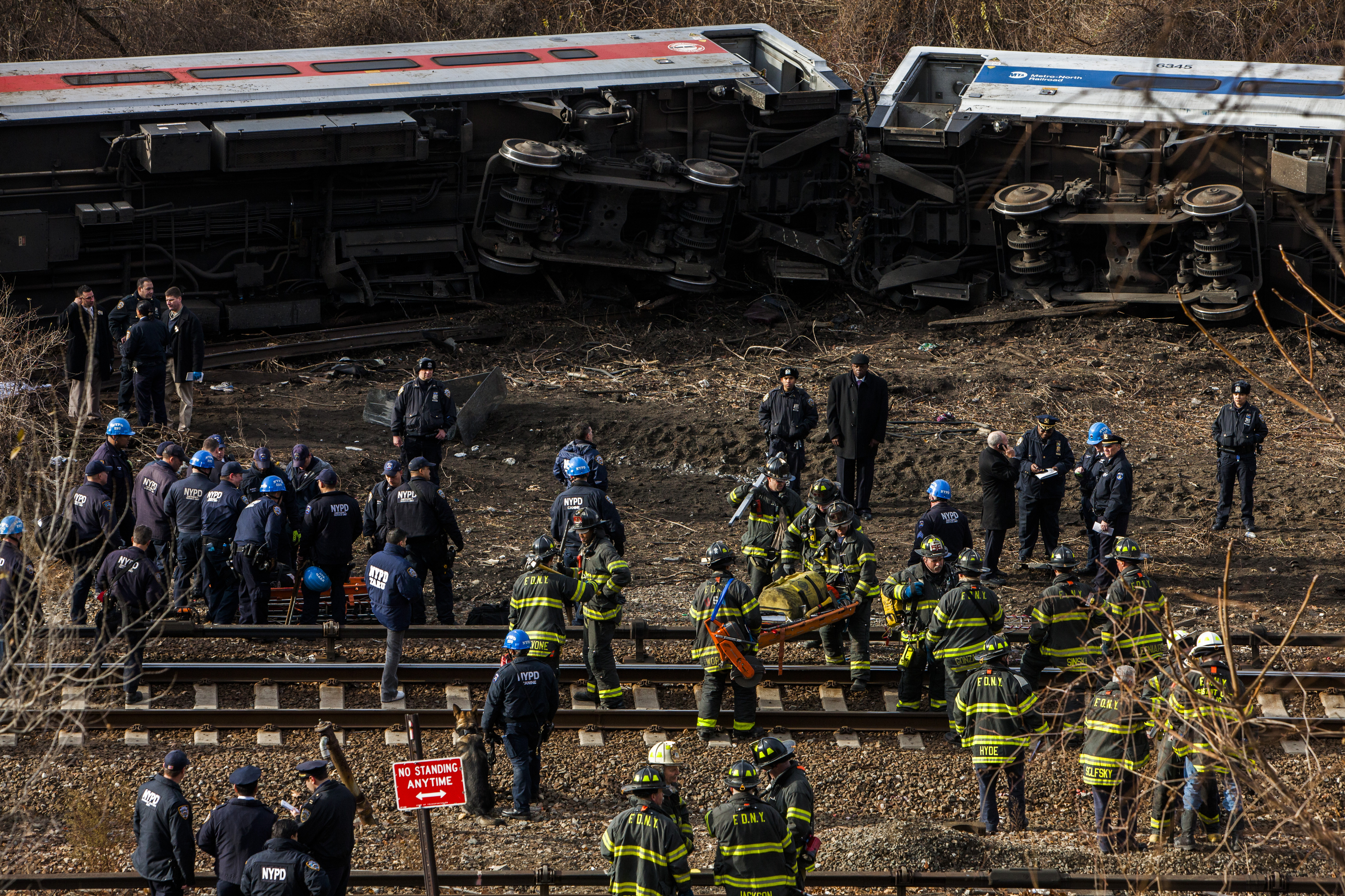 Police, firefighters and federal investigators at the site of the Metro-North derailment in New York, 2013.