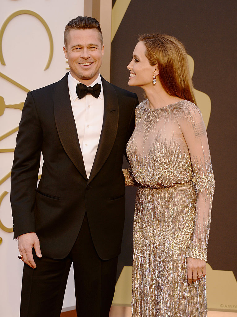 HOLLYWOOD, CA - MARCH 02: Actors Brad Pitt (L) and Angelina Jolie attend the Oscars held at Hollywood & Highland Center on March 2, 2014 in Hollywood, California.