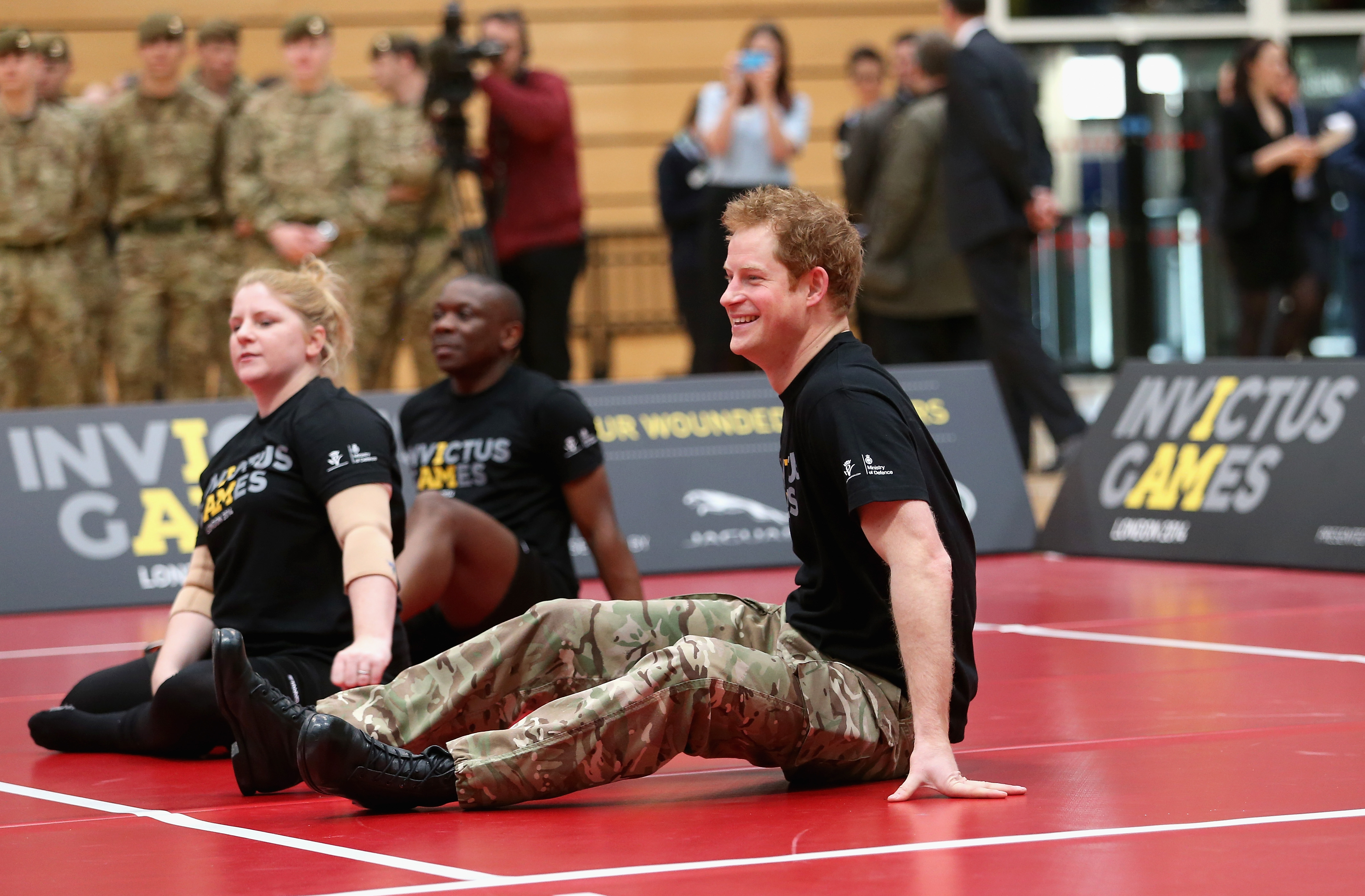 Prince Harry plays sitting volleyball as he takes part in a match at the media launch for the Invictus Games 2014 at the Copper Box Arena in the Olympic Park on March 6, 2014 in London, England. The Invictus Games for wounded, injured and sick serivce personnel will use the power of sport to inspire recovery, support rehabilitation and generate a wider understanding of those who serve the country. Prince Harry has brought the Games to the UK following a trip to see the Warrior Games in Colorado in 2013. 300 competitors from around the world will take part from the 10th-14th September.