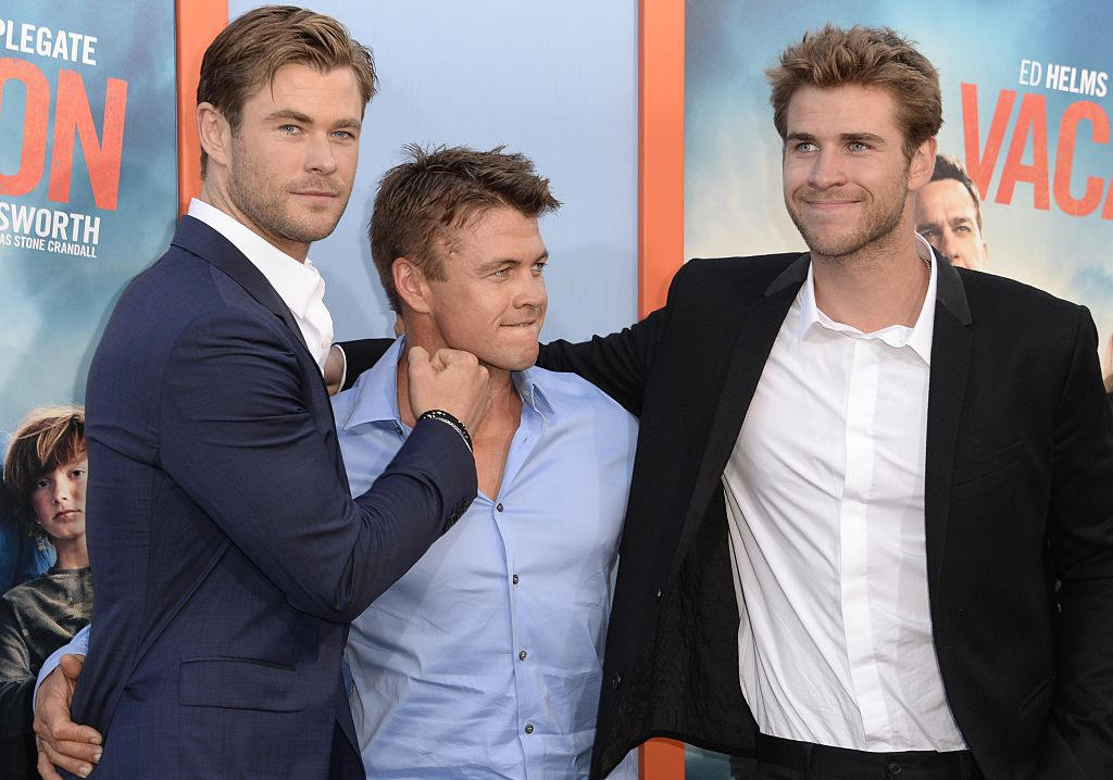 """(L-R) Brothers Chris, Luke and Liam Hemsworth arrive for the premiere of Warner Bros' """"Vacation"""" at the Regency Village Theatre in Los Angeles on July 27, 2"""