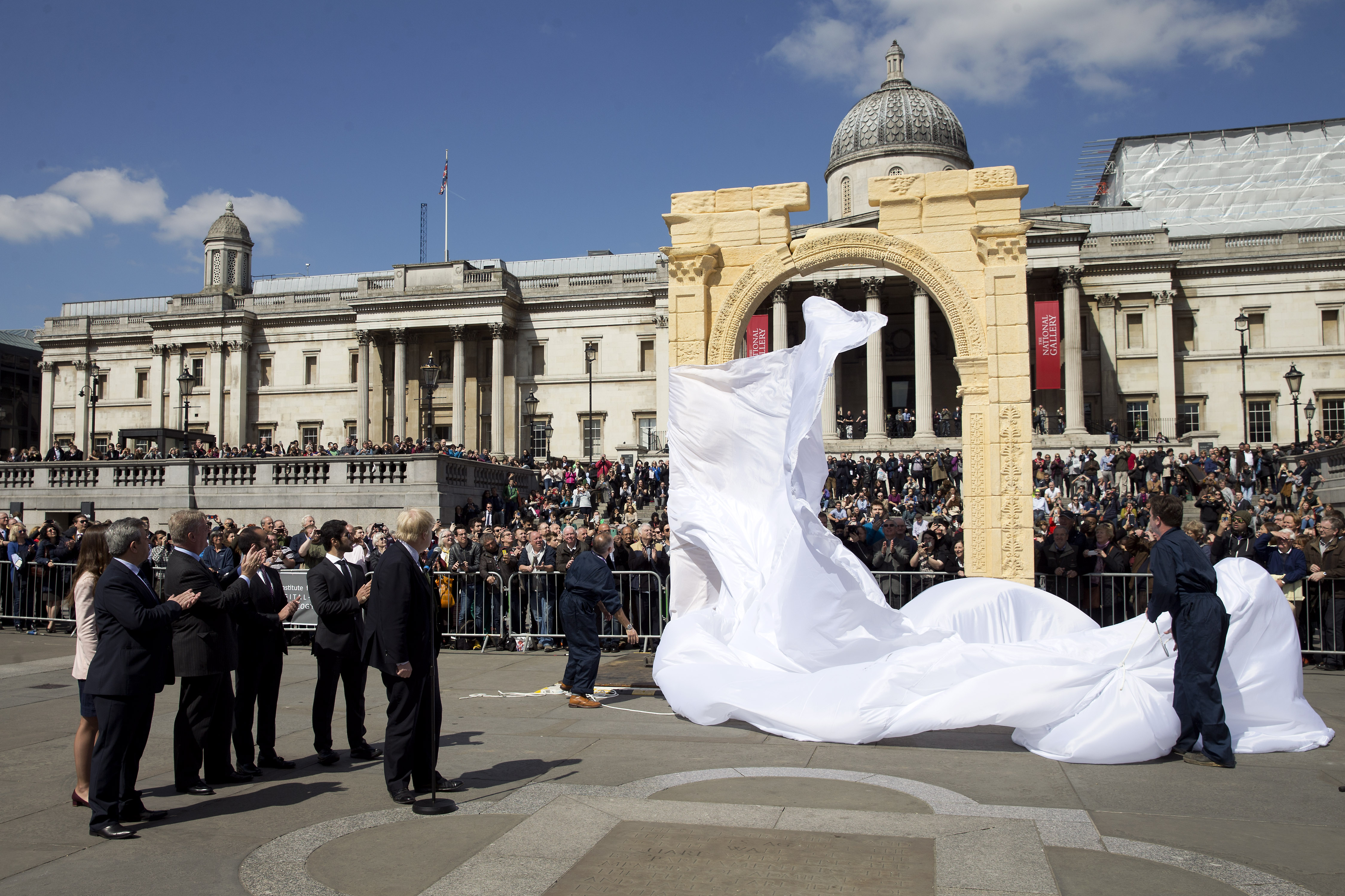 Mayor of London Boris Johnson (L) watches during the unveiling of a replica of Palmyra's Arch of Triumph in Trafalgar Square, central London, on April 19, 2016. The original arch was destroyed by the Islamic State (IS) and the replica has been crafted using the latest 3D printing and carving technologies by the Institute for Digital Archaeology.