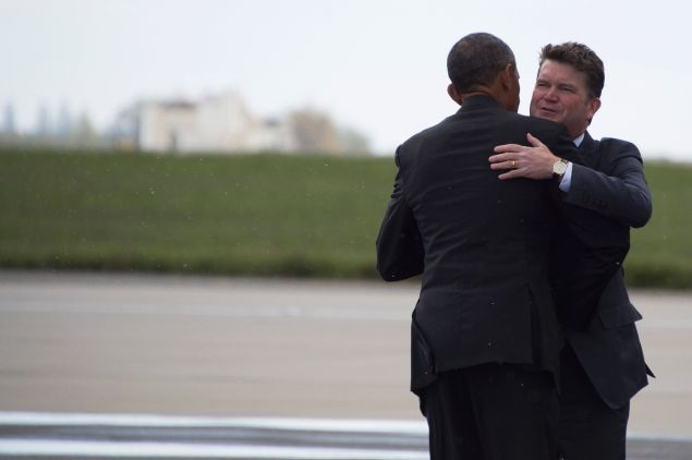 US President Barack Obama (L) bids farewell to US Ambassador to Britain Matthew Barzun at London's Stansted airport on April 24, 2016.
