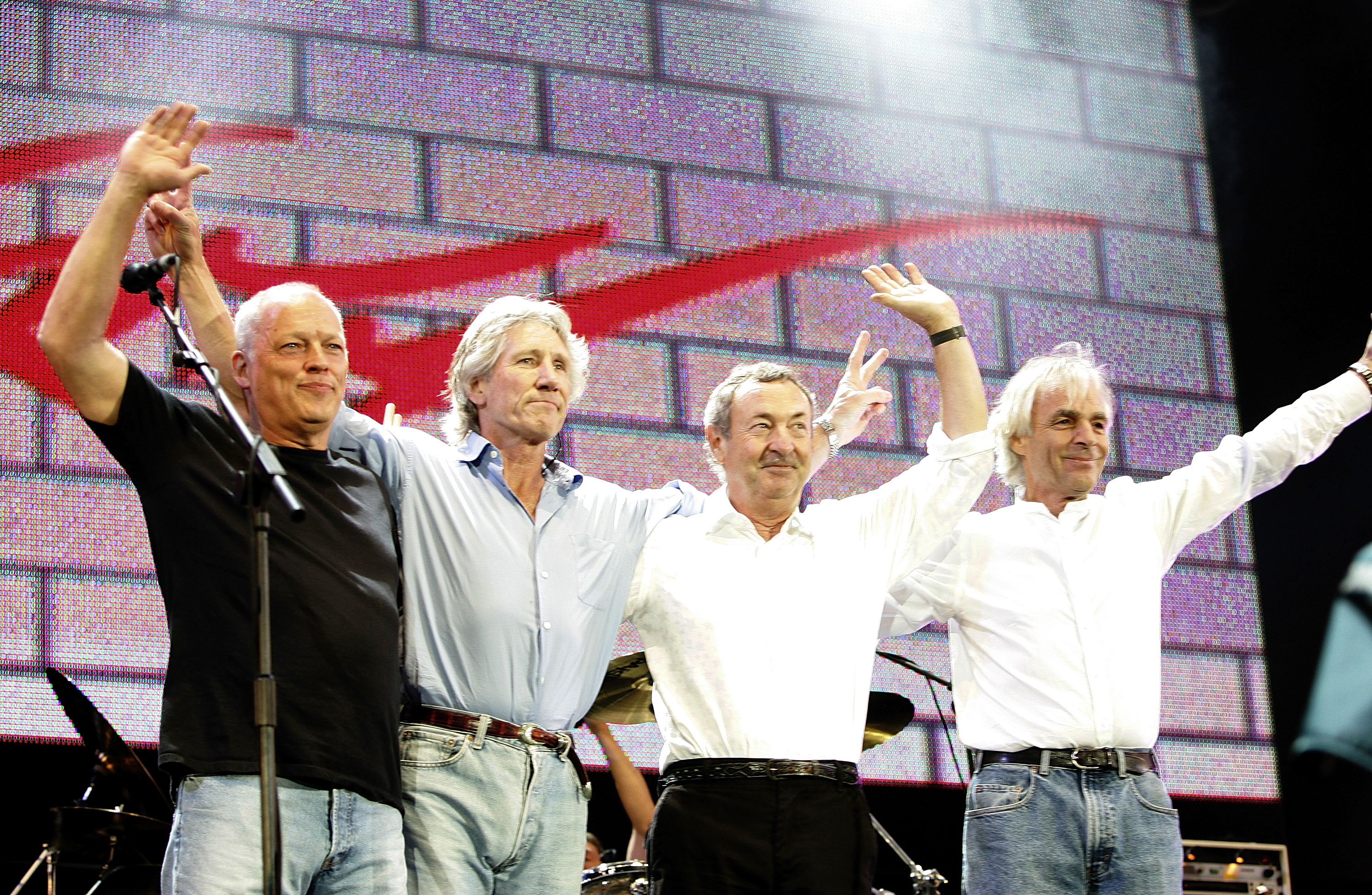 """LONDON - JULY 02: (L to R) David Gilmour, Roger Waters, Nick Mason and Rick Wright from the band Pink Floyd on stage at """"Live 8 London"""" in Hyde Park on July 2, 2005 in London, England. The free concert is one of ten simultaneous international gigs including Philadelphia, Berlin, Rome, Paris, Barrie, Tokyo, Cornwall, Moscow and Johannesburg. The concerts precede the G8 summit (July 6-8) to raising awareness for MAKEpovertyHISTORY."""