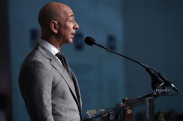 Amazon Founder and Washington Post owner Jeff Bezos delivers remarks during a naturalization ceremony on the 100th anniversary of Flag Day at the Smithsonian's National Museum of American History June 14, 2016 in Washington, DC.