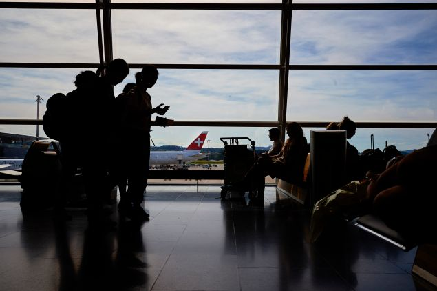 Passengers wait on July 6, 2016 at the Zurich Airport in Zurich.