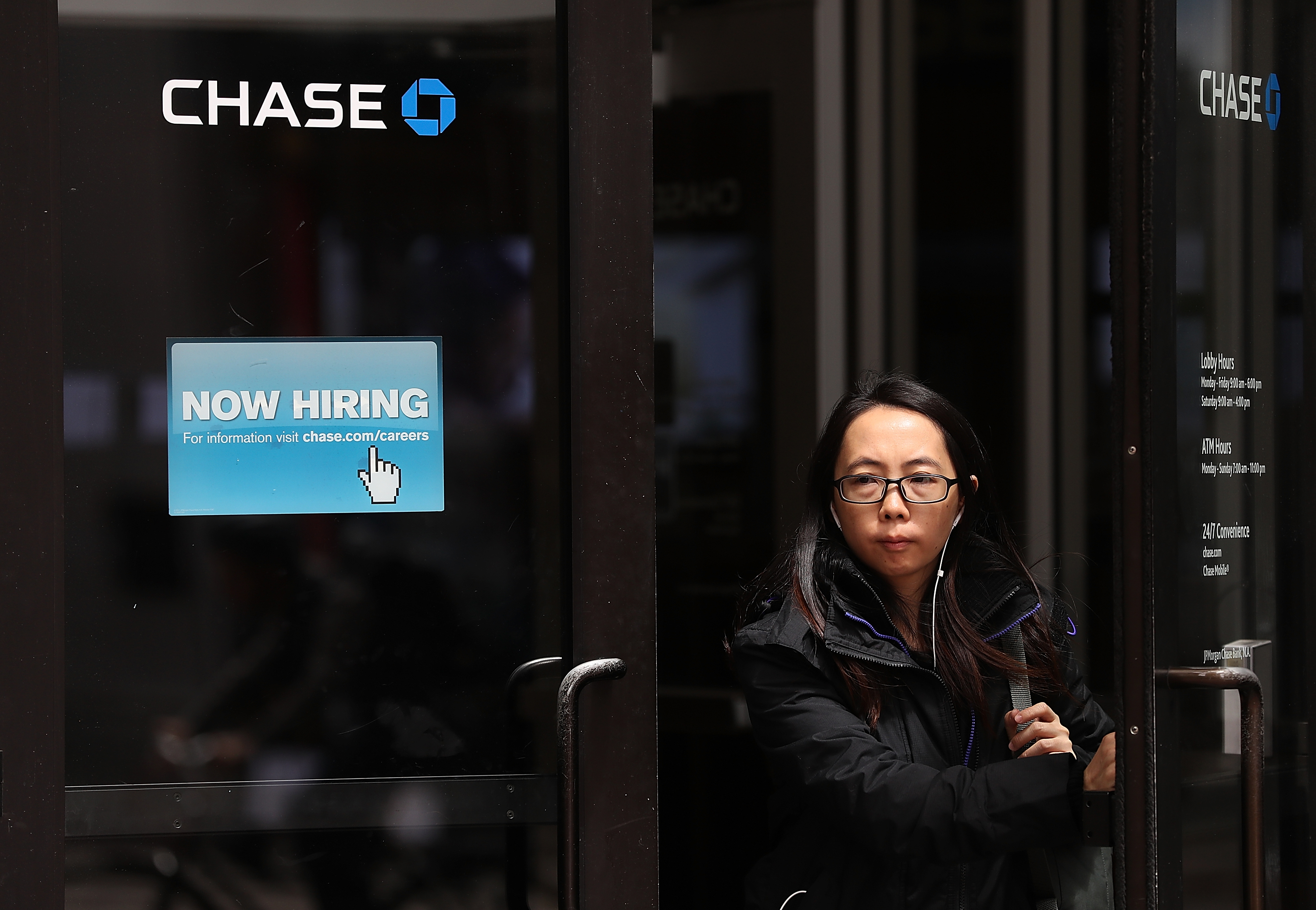 A 'now hiring' sign is posted outside of a Chase Bank office in San Francisco, California.