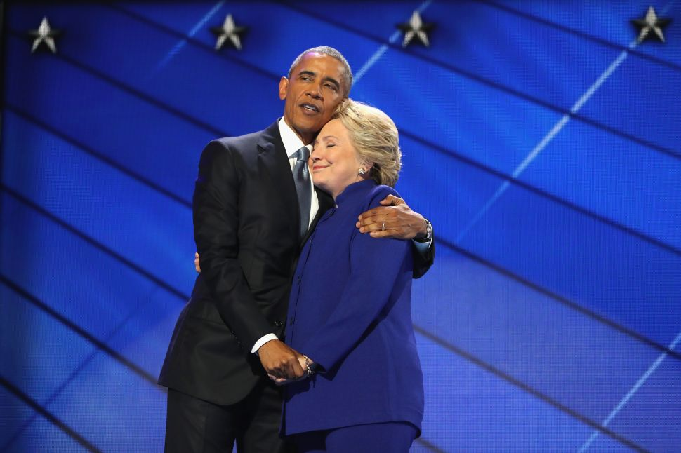 PHILADELPHIA, PA - JULY 27: US President Barack Obama and Democratic presidential candidate Hillary Clinton embrace on the third day of the Democratic National Convention at the Wells Fargo Center, July 27, 2016 in Philadelphia, Pennsylvania. Democratic presidential candidate Hillary Clinton received the number of votes needed to secure the party's nomination. An estimated 50,000 people are expected in Philadelphia, including hundreds of protesters and members of the media. The four-day Democratic National Convention kicked off July 25.