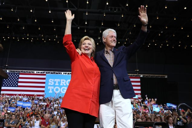 PITTSBURGH, PA - JULY 30: Democratic presidential nominee former Secretary of State Hillary Clinton and her husband former U.S. president Bill Clinton greet supporters during a campaign rally with democratic vice presidential nominee U.S. Sen Tim Kaine (D-VA) at the David L. Lawrence Convention Center on July 30, 2016 in Pittsburgh