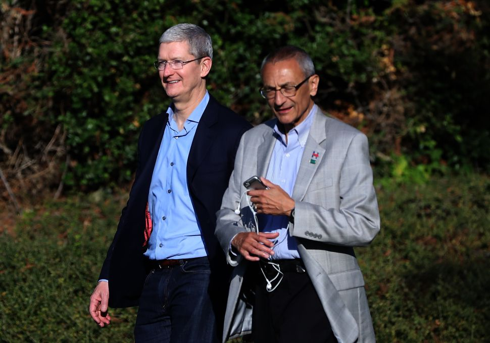 Apple CEO Tim Cook (L) and Hillary Clinton campaign chairman John Podesta leave a fundraiser for Hillary Clinton on August 24, 2016 in Los Altos Hills, California.