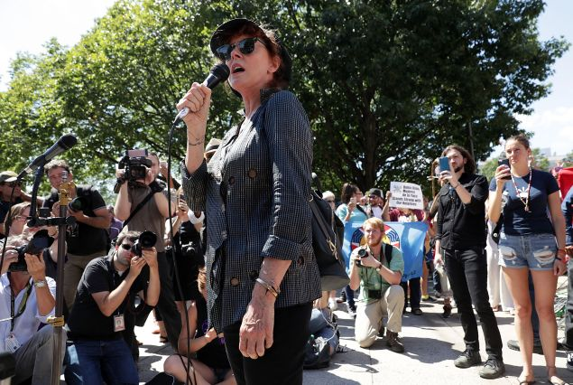WASHINGTON, DC - AUGUST 24: Actress Susan Sarandon (C) speaks as actress Shailene Woodley (R) and comedian Lee Camp (2nd R) look on during a rally on Dakota Access Pipeline August 24, 2016 outside U.S. District Court in Washington, DC