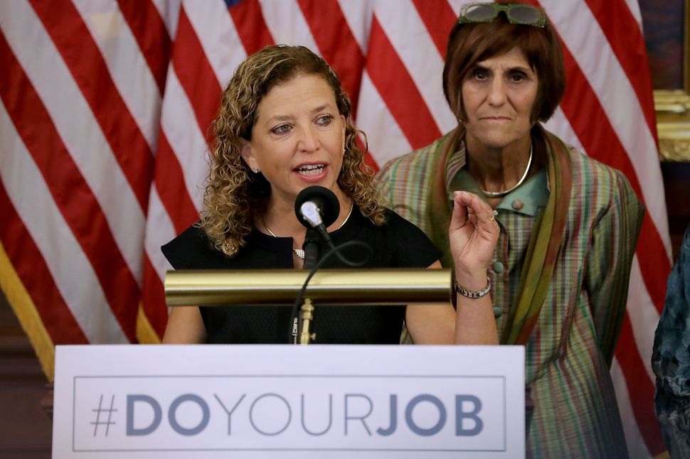 WASHINGTON, DC - SEPTEMBER 07: Democratic National Committee Chair Rep. Debbie Wasserman Schultz (D-FL) (L) and Rep. Rosa DeLauro (D-CT) join fellow Democratic members of the House for a news conference to call on Republicans to fund programs to combat the spread of the Zika virus at the U.S. Capitol September 7, 2016 in Washington, DC.