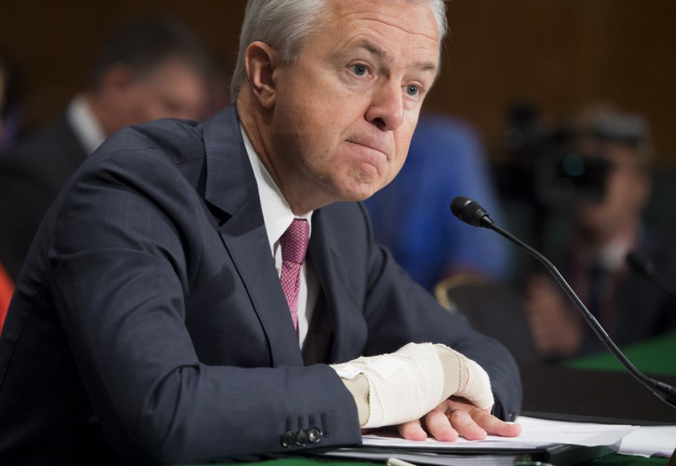 John Stumpf, chairman and CEO of Wells Fargo, testifies about the unauthorized opening of accounts by Wells Fargo during a Senate Banking, Housing and Urban Affairs Committee hearing on Capitol Hill in Washington, DC, September 20, 2016