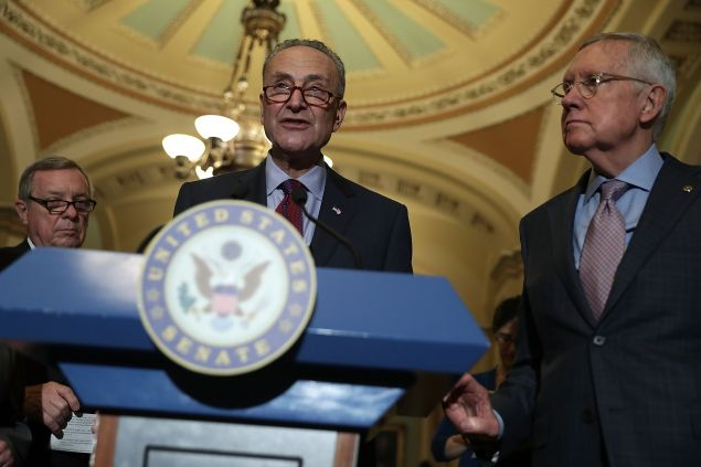 U.S. Sen. Charles Schumer (D-NY) (C) speaks as Senate Minority Whip Sen. Richard Durbin (D-IL) (L) and Senate Minority Leader Sen. Harry Reid (D-NV) (R) listen during a news briefing after a weekly policy luncheon at the Capitol September 20, 2016