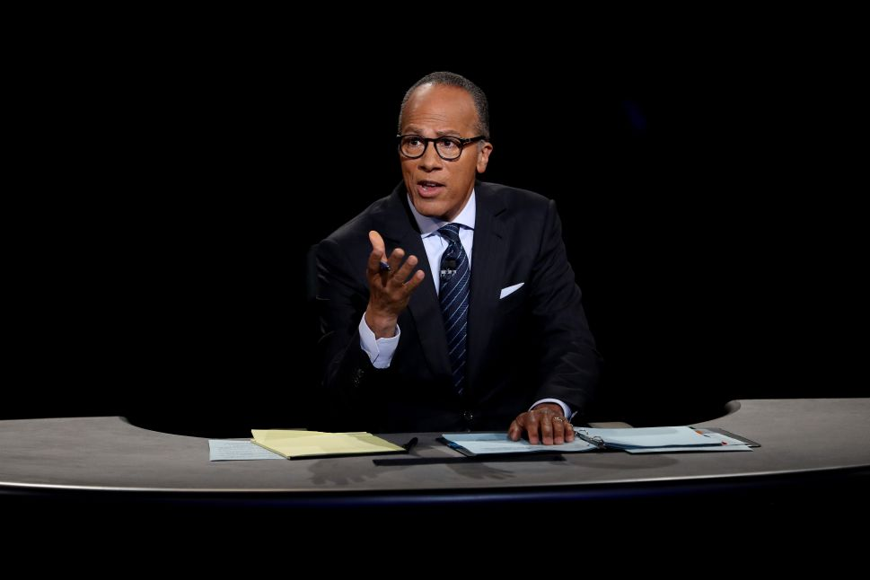 Moderator Lester Holt listens during the Presidential Debate at Hofstra University on September 26, 2016 in Hempstead, New York.