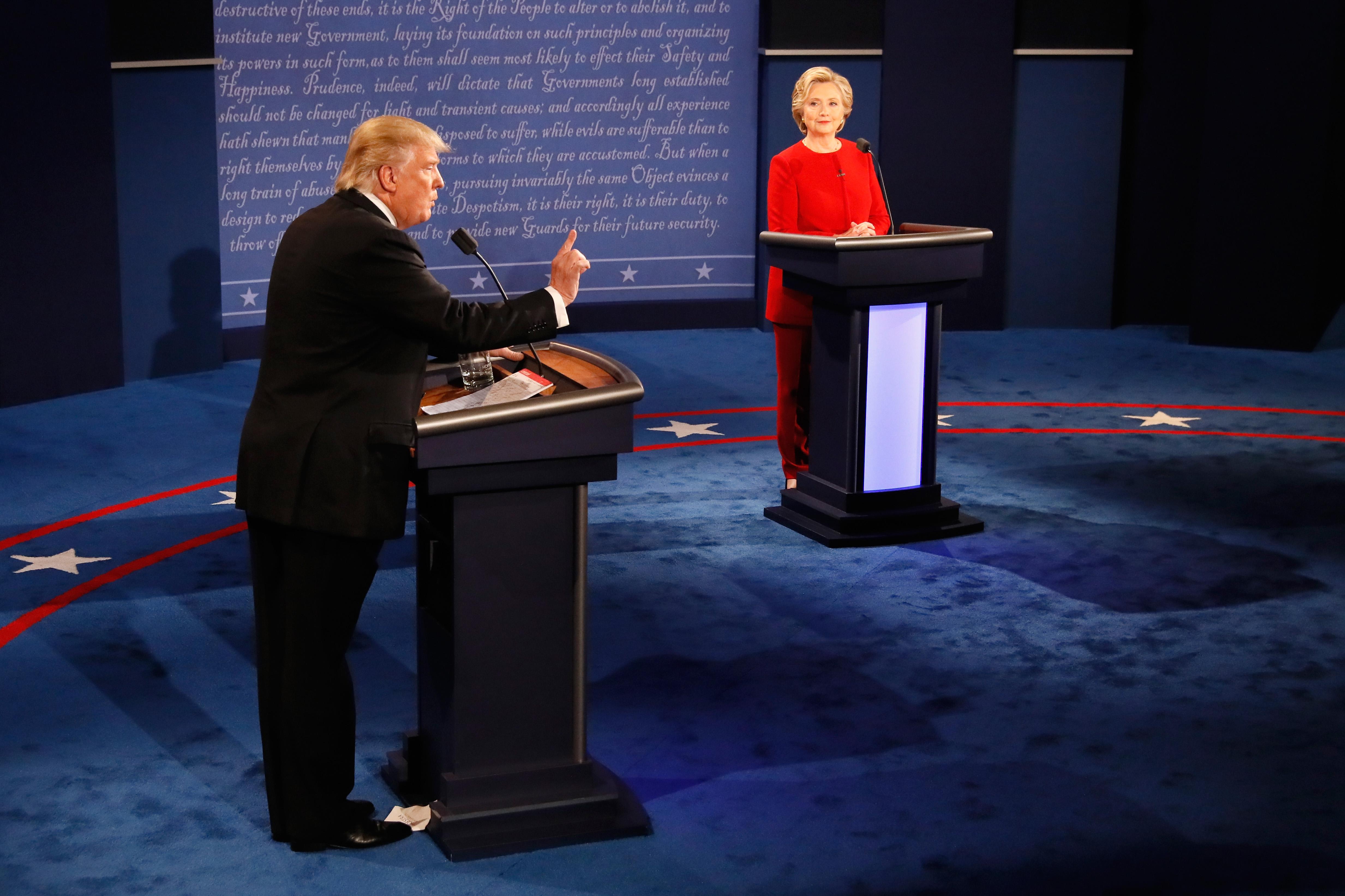 Republican presidential nominee Donald Trump (L) speaks as Democratic presidential nominee Hillary Clinton (R) listens during the Presidential Debate at Hofstra University on September 26, 2016 in Hempstead, New York