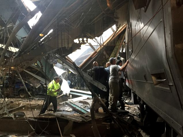 Train personnel survey the NJ Transit train that crashed in to the platform at the Hoboken Terminal September 29, 2016 in Hoboken, New Jersey.