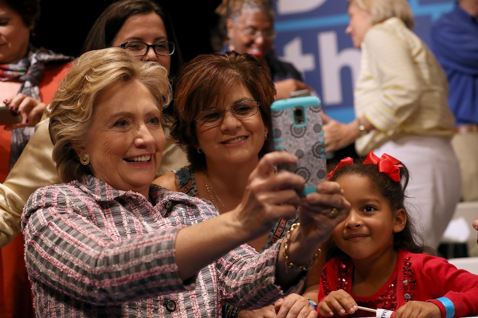 Democratic presidential nominee former Secretary of State Hillary Clinton greets supporters before delivering a speech on national service at Sunrise Theatre on September 30, 2016 in Fort Pierce, Florida. Hillary Clinton is campaigning in Florida.