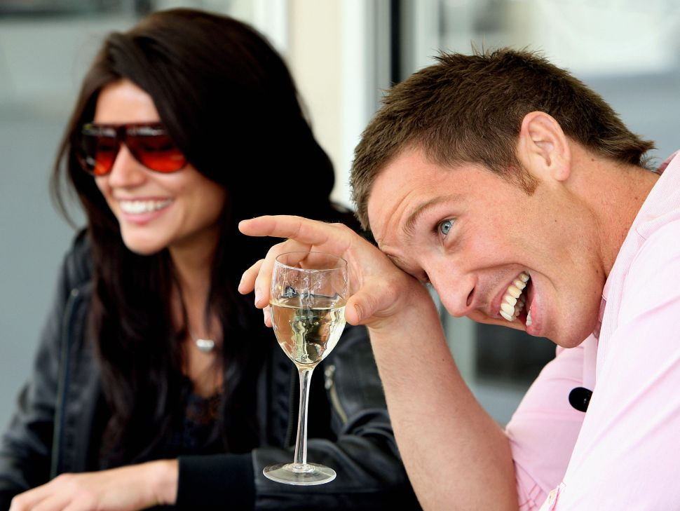 "Paul Bardetta (R) of Sydney, laughs as he talks with his celebrity date and local television host Brooke Sheehan (L), during an online dating promotion by Australia's only live, mobile dating website ""Partner4Real"", in Sydney, 17 September 2007. Over the next week Bardetta will date 20 women at his portable house on Circular Quay in Sydney, selecting one to take to Paris with him as a prize. AFP PHOTO/Greg WOOD"