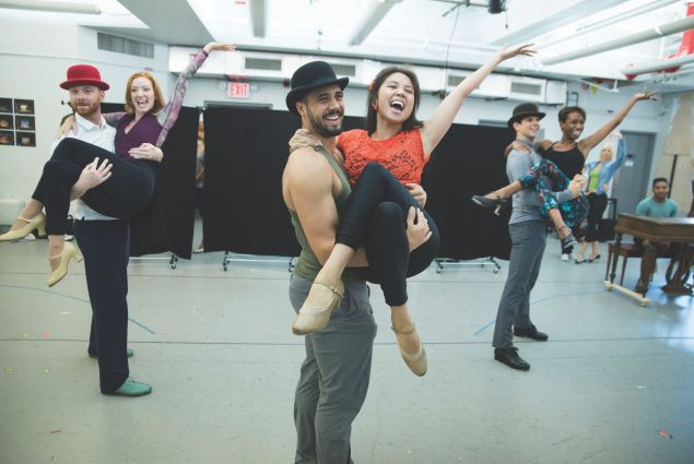 Cast members rehearse a number from Holiday Inn.