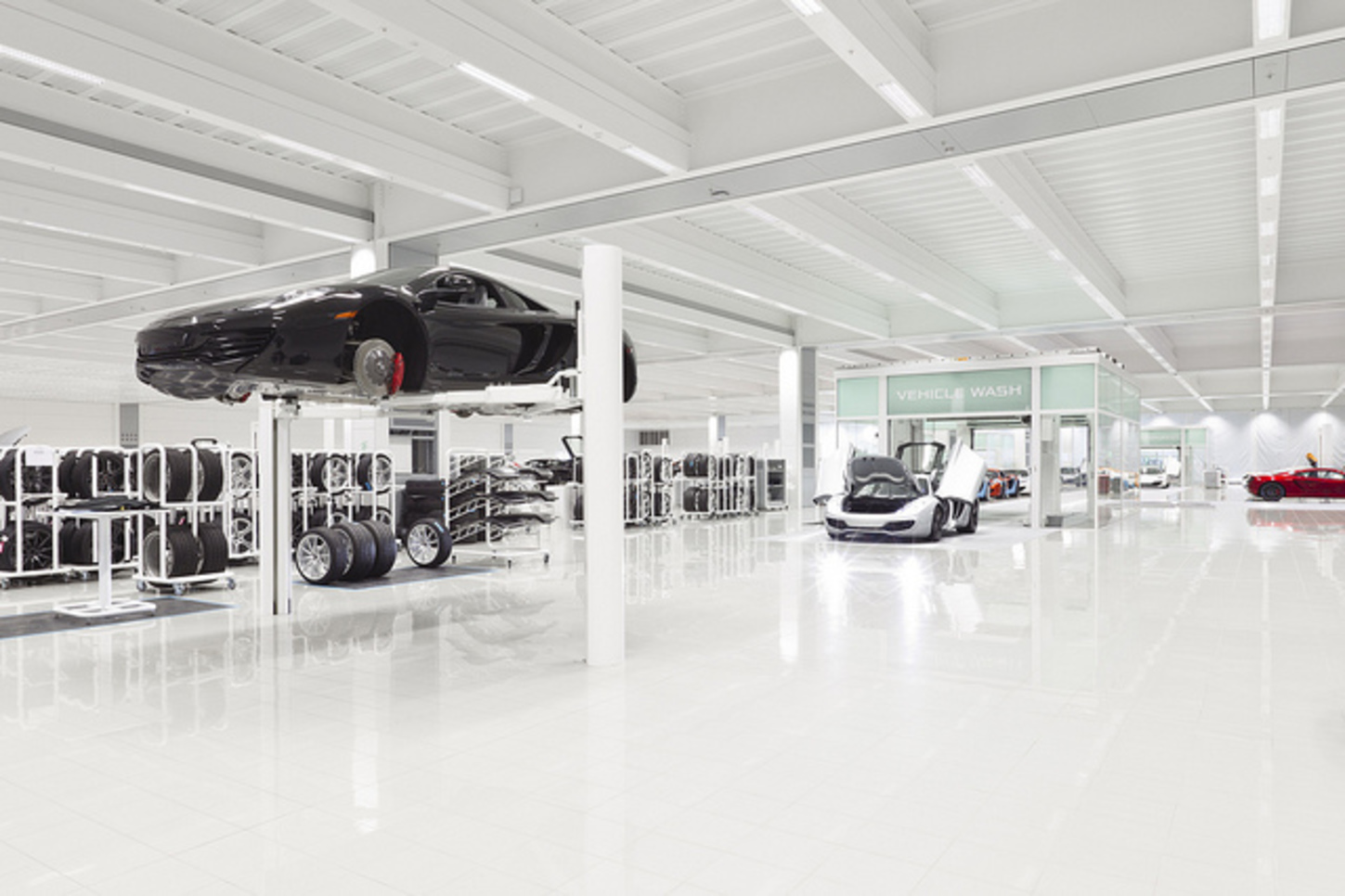 McLaren has clear aesthetic links with Apple. Inside the the Woking production centre.