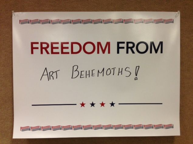A poster from the outpost of For Freedoms (the super PAC and artwork by Hank Willis Thomas) at Expo Chicago.