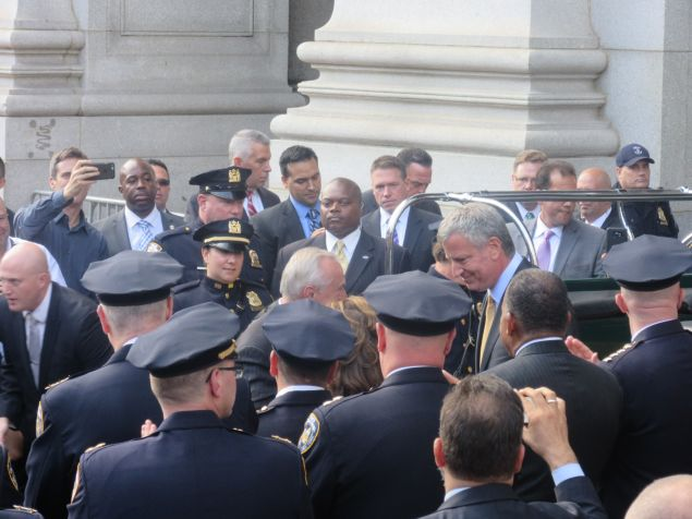 Outgoing Police Commissioner Bratton and Mayor de Blasio after sharing a hug on his last day.