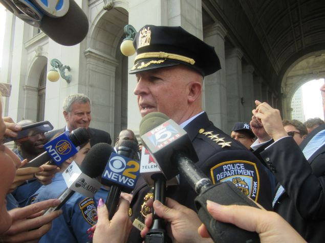 The city's new top cop, Police Commissioner James O'Neill, addresses reporters following the processional.
