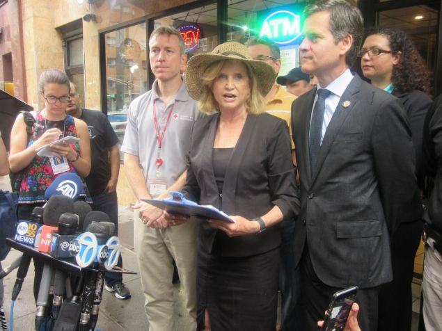 Congresswoman Carolyn Maloney addresses reporters near the scene of the Chelsea explosion.