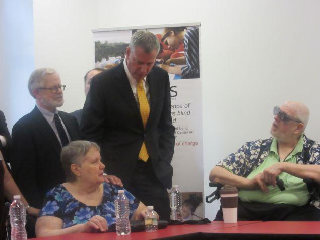 Mayor Bill de Blasio speaks with residents.