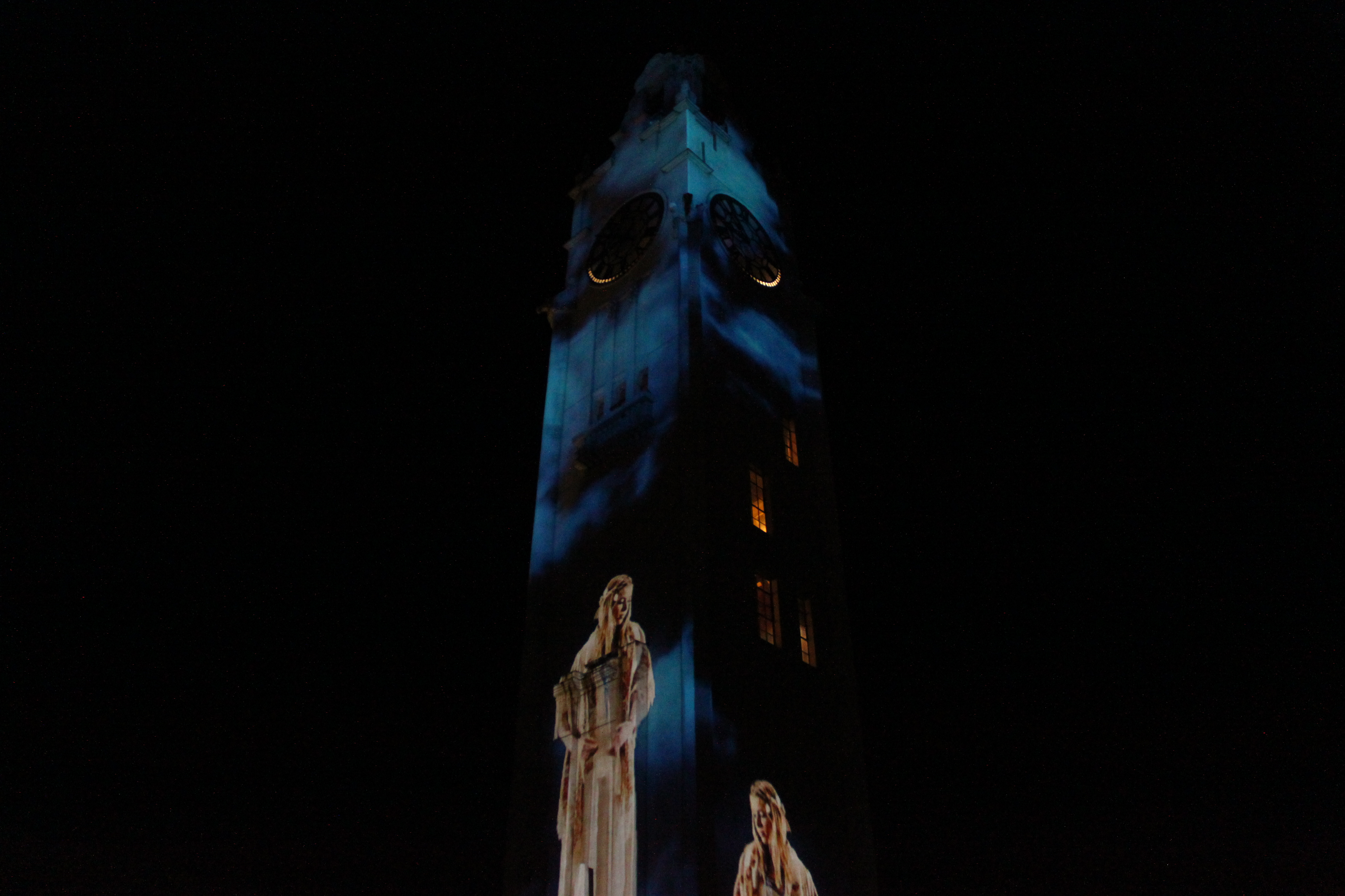 """Suzanne"" projected on the clock tower at Montreal's old port."