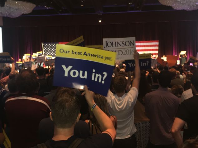 The crowd raises campaign signs before Gov. Gary Johnson steps onstage.