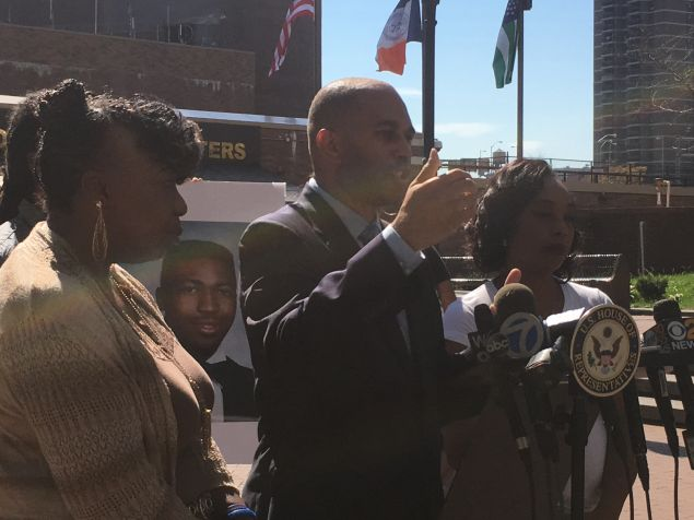 Congressman Hakeem Jeffries, center, flanked by Gwen Carr, left, and Constance Malcolm, right.