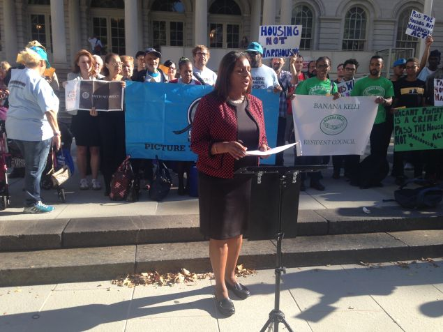 Public Advocate Letitia James speaking at a press conference blasting the number of vacant properties in the city.