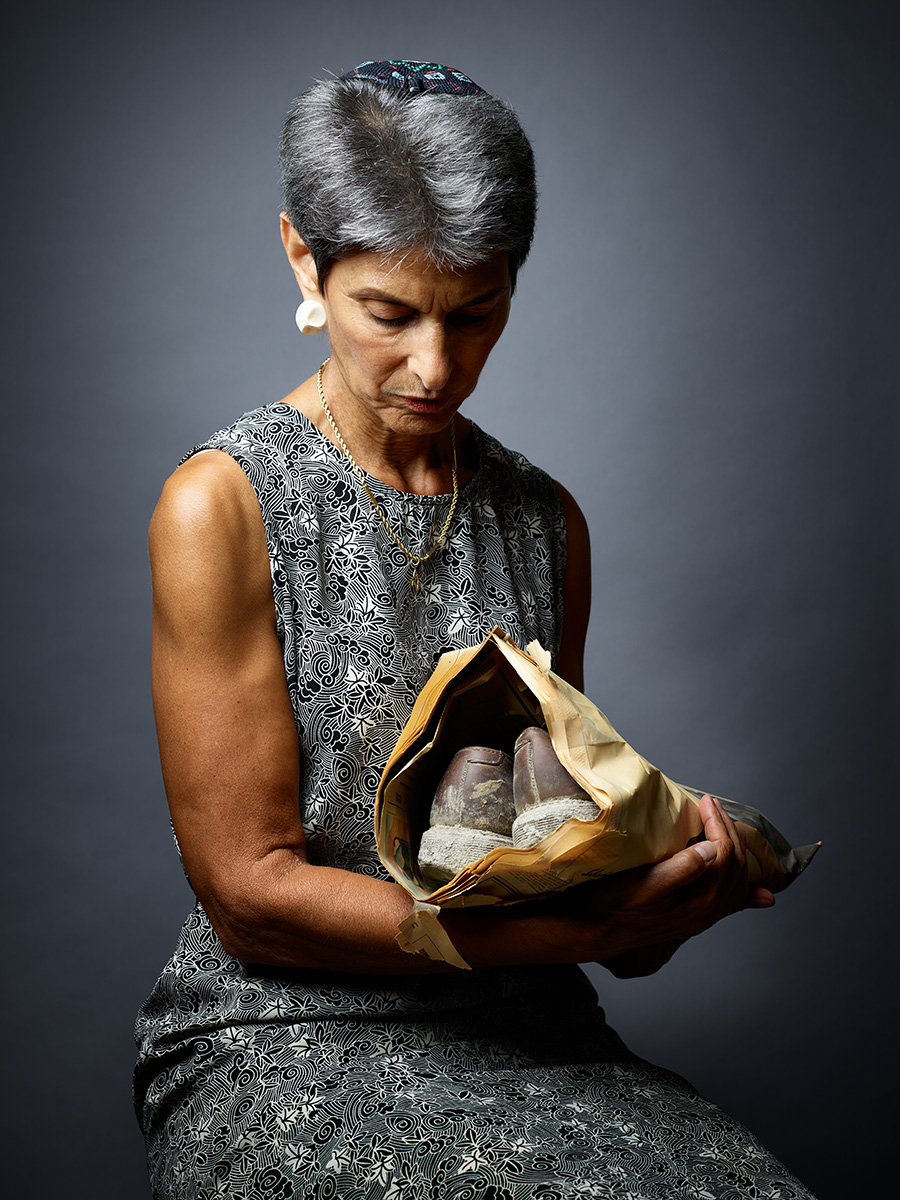 Rabbi Janise Poticha cradles the ash-covered shoes she wore on 9/11.