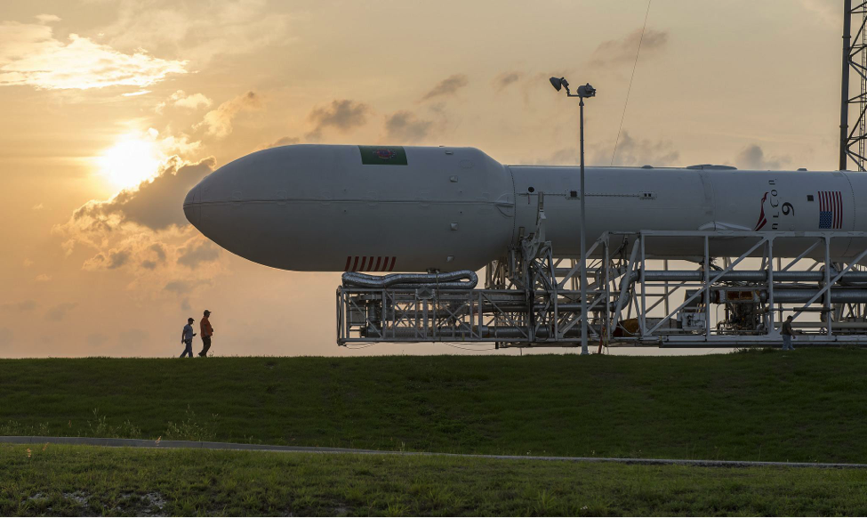 The SpaceX Falcon 9 rocket being rolled out for launch