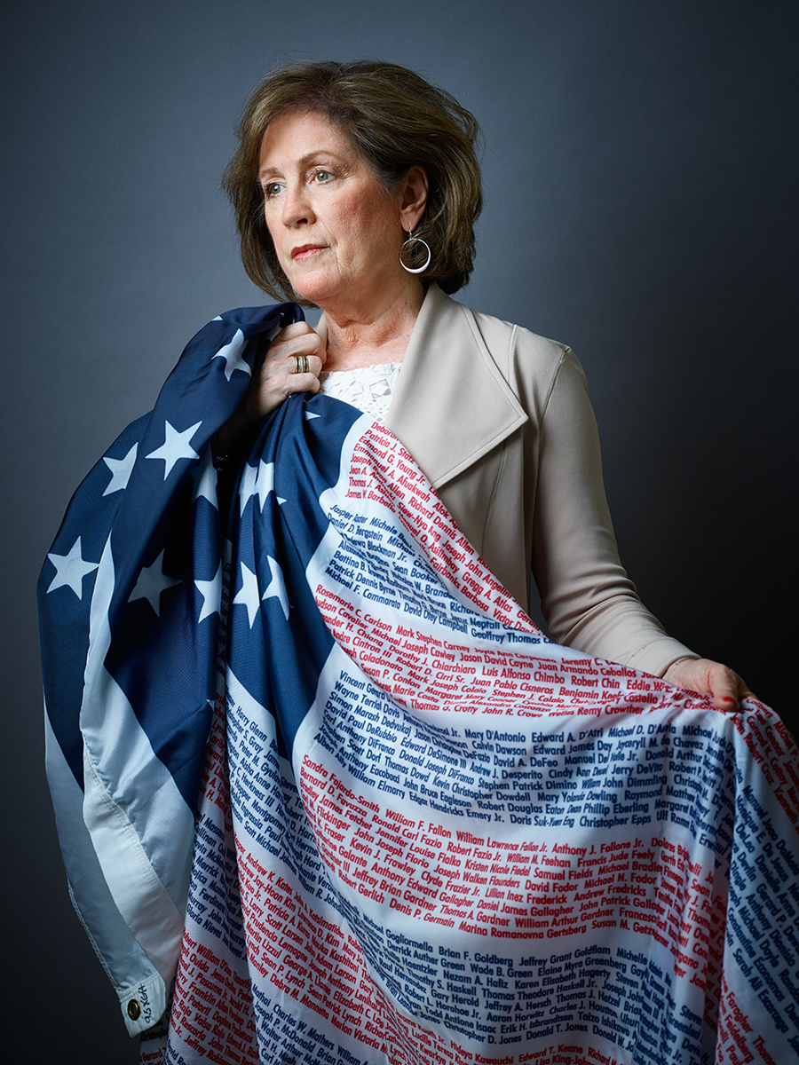 Mary Fetchet holds a flag with the names of all 9/11 victims, including her son.