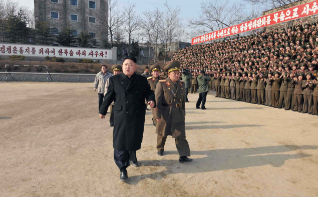 This undated picture released from North Korea's official Korean Central News Agency (KCNA) on January 12, 2014 shows North Korean leader Kim Jong-Un (front L) inspecting the command of Korean People's Army (KPA) Unit 534.