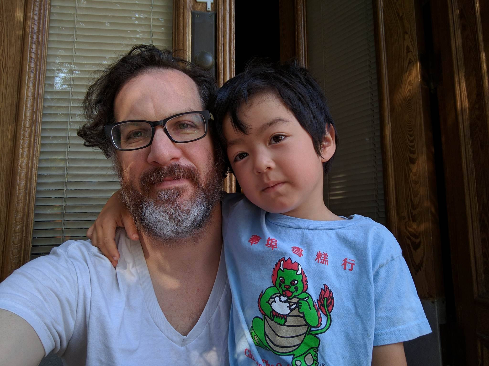 Todd with his young son
