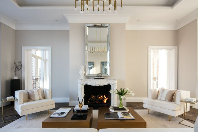A fireplace with a marble mantle and a neutral color palette in one of Cheryl Eisen's Park Avenue projects.