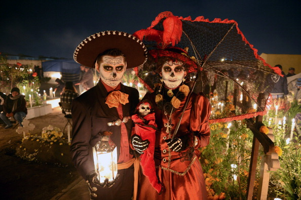 A couple disguised as dead poses at San Jeronimo Chicahualco cemetery in Metepec, Mexico during the commemoration of the Day of the dead.