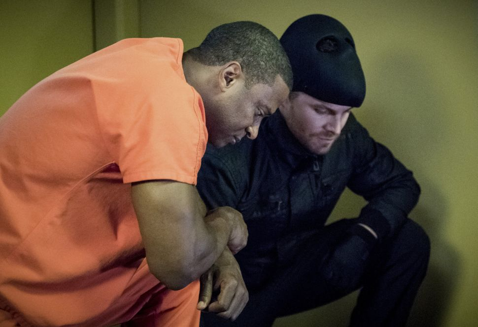David Ramsey as John Diggle and Stephen Amell as Oliver Queen.
